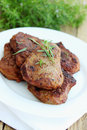 Pork schnitzel with fresh savory on plate Stock Photo