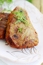 Pork schnitzel on plate with fresh savory Royalty Free Stock Images