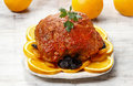 Pork served on oranges and plums Stock Image