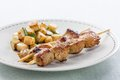 Pork skewer with fried zucchini Royalty Free Stock Photos