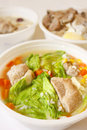 Pork soup with cabbage, corn and carrot Stock Photos