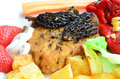 Pork steak with morels served and decorated macro shot of morel mushrooms french recipe on white plate french fries red pepper in Royalty Free Stock Photography