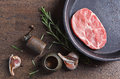 Pork steak with rosemary, garlic and pepper , top view Royalty Free Stock Photo