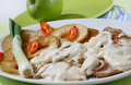 Pork steak in yogurt sauce Stock Images