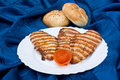 Pork steaks with loafs of bread Royalty Free Stock Images