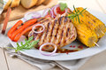 Pork steaks and vegetables Royalty Free Stock Photos