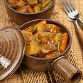 Pork stew slow cooker selective focus Stock Images
