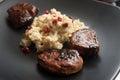 Pork tenderloin cheesy cauliflower gratin with pomegranate and thyme garnish Royalty Free Stock Photography