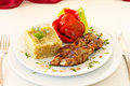 Pork tenderloin with scraped potatoes and pickled peppers Stock Photo