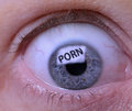 Porn addiction concept of an eye looking at a screen of pornography Royalty Free Stock Images