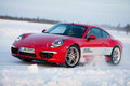 Porsche carrera s levi finland feb unknown driver powerslides a car during driving experience snow ice press event on Royalty Free Stock Photo
