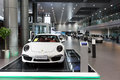 Porsche cars for sale in showroom lined up dealership Royalty Free Stock Images