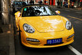 Porsche the is parking on the side of the road in shanghai Royalty Free Stock Photo