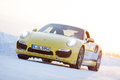 Porsche turbo levi finland feb unknown driver drives a car during driving experience snow ice press event on february in Stock Photo