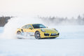 Porsche turbo levi finland feb unknown driver powerslides a car during driving experience snow ice press event on february Stock Image