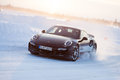 Porsche turbo levi finland feb unknown driver powerslides a car during driving experience snow ice press event on february Royalty Free Stock Photo