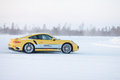 Porsche turbo levi finland feb unknown driver powerslides a car during driving experience snow ice press event on february Stock Photography