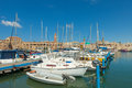 Port of acre israel with boats and the old city in the background Stock Image