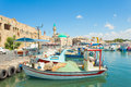 Port of acre israel with boats and the old city in the background Royalty Free Stock Images