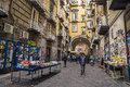 Port alba remnant of one of the city gates of naples italy with via d historic street booksellers in old town Royalty Free Stock Photography