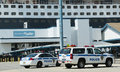 Port authority police new york new jersey providing security for queen mary cruise ship docked at brooklyn cruise terminal city Stock Images