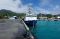 Port of avatiu island of rarotonga cook islands sep inter cargo ship in on sep cooks reef passages are too narrow or too shallow Royalty Free Stock Image