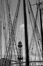 Port of barcelona black and white picture sant sebastià cable car tower in barceloneta as seen through the ropes and masts a Royalty Free Stock Photo