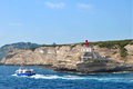 Port of bonifacio corsica view harbour with tourists boat and red lighthouse on corsican rocks at the entrance to the Royalty Free Stock Image