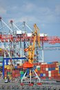 Port cargo crane and container over blue sky background Royalty Free Stock Images