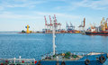 Port cargo crane and container over blue sky background Stock Photo