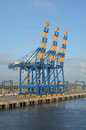 Port cargo crane mooring container awaiting operations Stock Photos