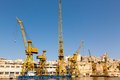 Port cargo crane in shipyards harbor of malta clear weather on a background blue sky Stock Photography