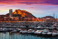 Port  and Castle of Santa Barbara during sunset. Alicante Royalty Free Stock Photo