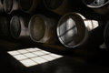 Port cellar wooden barrels hold fortified wine to mature in wine cellars Royalty Free Stock Image