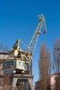 Port crane big old on blue sky background Stock Photos