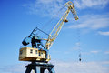Port crane lowered boom in Royalty Free Stock Images