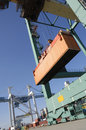Port crane lowering container Royalty Free Stock Image