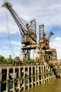 Port crane old on the river thames in london england Royalty Free Stock Photography