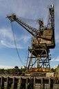 Port crane old on the river thames in london england Royalty Free Stock Photo