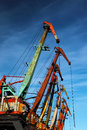 Port cranes old on the blu sky background Royalty Free Stock Photos