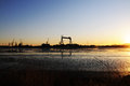Port Cranes, Seacoast Sunset, Cargo and Shipping Industries Royalty Free Stock Photo