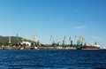 Port with cranes and ships cargo ship Royalty Free Stock Photos