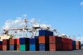 Port cranes and stacks of shipping containers Royalty Free Stock Photos