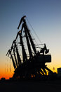 Port cranes on sunset industrial view of background Stock Image