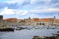 Port in dubrovnik croatia city harbor with cozy backyards famous old town fortress on the adriatic Stock Image