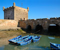 Port in essaouira blue fishing boats and historical bastion morocco on the atlantic coast north africa Royalty Free Stock Image