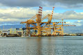 Port of honolulu giant shipping cranes located in the on oahu hawaii Stock Images