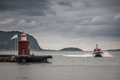 Port a rescue boat is approaching the of alesund in norway Stock Images