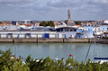 Port of saint gilles croix de vie in france with church sainte the background commune the vendée department the pays la Royalty Free Stock Images