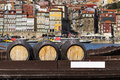 Port Wine barrels in a boat in the Douro River with the city of Porto in the background Royalty Free Stock Photo